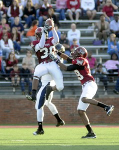 Troy cornerback Ladarruis Madden (30) intercepts a pass intended for Florida International wide receiver Willis Wright (1) during the first half an NCAA football game in Troy, Ala., on Saturday, Nov. 13, 2010. (Messenger Staff Photo/Thomas Graning)