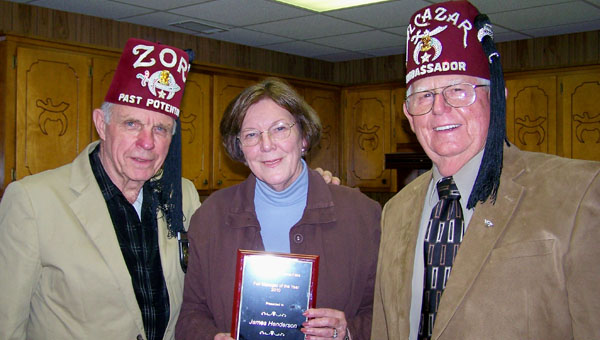James Henderson, Pike County Fair manager, has been named the 2011 Fair Manager of the Year by the Association of Alabama Fairs. Henderson has been the manager of the local fair for 13 years. Pictured with Henderson, right, are Homer Homann, past potentate, president and Judith Henderson.