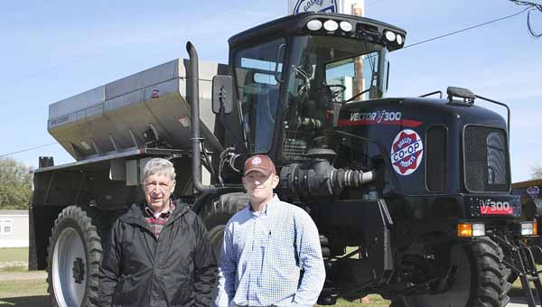 Colin Morris, Goshen and Ariton Farmers Cooperatives general manager, right, and Jack Norton, Goshen Farmers Co-op board member, were on hand Monday for the delivery of a Vector 300 spreading machine that will be available to area farmers. The machine spreads fertilizer at a variable rate, which means greater cost savings to farmers.