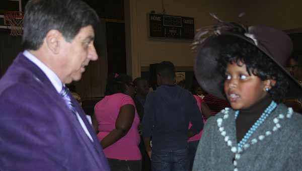 Jimmy Ramage listened intently as India Lee told about Dorothy Height's involvement in the Civil Rights movement. Lee was one of 46 fourth-grade students who participated in the Black History Wax Museum at Pike County Elementary School Tuesday.