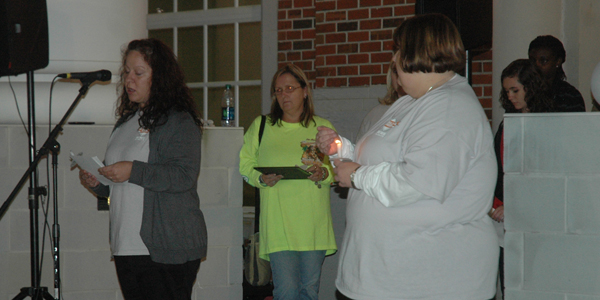Troy University students read accounts of bullying victims during the candlelight vigil.