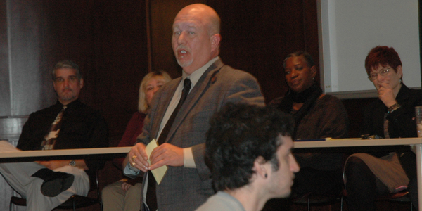 Troy's Dr. Faircloth facilitated discussion and acted as moderator during the town hall meeting.