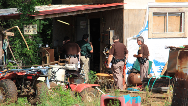 The Pike  County Sherriff department  investigates the scene of after a meth lab bust  on County Road 3310 Wednesday afternoon. (Messenger Photo / April Garon)