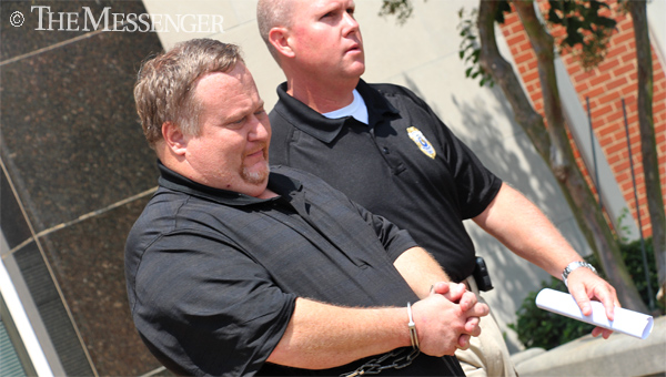 Derrick Ray Thompson, 41, is transported from the Pike County Courthouse Tuesday morning. Thompson, of Pensacola, Fla., is wanted in connection with three murders in Florida and was captured early Tuesday morning in Troy. (Messenger Photo / April Garon )
