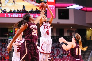 Troy University Athletics Ashley Beverly-Kelley shoots the ball over a Texas State defender. Beverly-Kelley finished the game with a season-high 32 points.