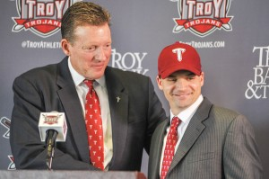 Troy Athletic Director John Hartwell poses with new Trojan head coach Neal Brown. Brown returns to Troy after coaching under Larry Blakeney from 2006-2009. (Troy Messenger/Joey Meredith)