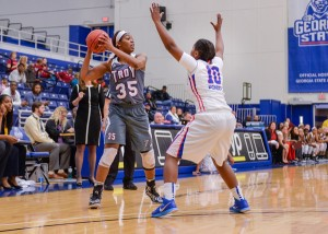 Troy University Athletics Kourtney Coleman looks to pass the ball over a Georgia State defender. Coleman was a perfect 6-of-6 from 3-point range Saturday against the Panthers.