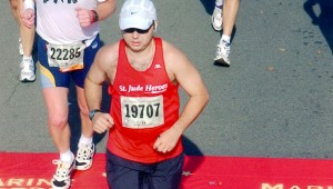 Greg Price runs in the Marine Corps Marathon in Washington, D.C. in 2004. Inset, Price runs in the Mercedes Marathon in Birmingham in 2013. Price began to run competitively at 14 years old and  continues to run today. Since then, he has logged over 64,000 training and competition miles.