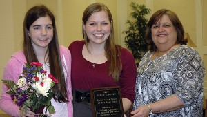 Melissa Cannon, center, a Troy University elementary education major, has been named the Troy Public Library's 2014 Outstanding Tutor of the Year. The award was presented by Teresa Colvin, TPL children's librarian on Friday.  Also, pictured is Anna Fountain who congratulated Cannon on the award.