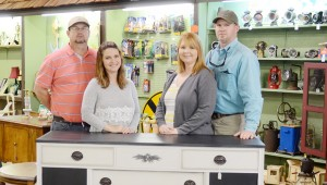 Left to right, Shane and Trudie Smith and Dan and Kristie Freeman, owners of Pickin' & Grinin' and 2 Sister Closet. The two businesses share a builing located on Main Street in Brundidge.