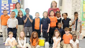 Debra Kelly's first grade class at TES with the can tabs collected. MESSENGER PHOTO/COURTNEY PATTERSON