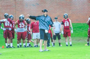 "Troy University Athletics New Troy head coach Neal Brown directs the Trojans' first practice of the spring on Tuesday. Brown described his first practice as head coach as ""fun."""