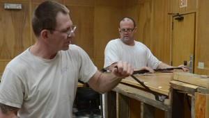 Workers from the Alabama Correctional Industries remodeling the courtroom at the Pike County Courthouse.