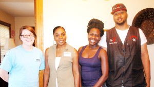 Dorothy Howard, left center, has worked with expecting mothers in Troy for 10 years. Howard stands with some of her students, from left, Kayla Hall, Ashley Bell and Joseph Fields. MESSENGER PHOTO/COURTNEY PATTERSON