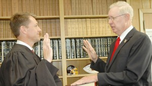 Messenger Photo/Jaine Treadwell Judge Wes Allen administered the oath of office to Randy Hale at a ceremony at the Pike County Courthouse Thursday. hale was appointed the resident director for Pike County.