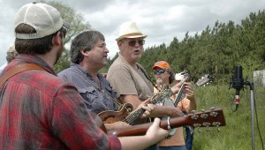 """Bluegrass music could be heard on the Springhill """"exit"""" of the Henderson highway around noon as people gathered for the unveiling of the sign at would designate the highway as the Rex Locklar Memorial Bluegrass Highway. Brandon Bostic, Mark Carter, Bobby Jackson and Ben Hughes were among the pickers."""