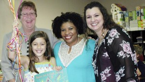 Messenger Photo/Jaine Treadwell Pike Liberal Arts School third-grader Kate Nelson is the winner of the 2015 TroyFest T-shirt Design Contest. Pictured from left are Beck Baggett, PLAS headmaster, Nelson, Catherine Jordan, contest chair and Rachel Woodham, Kate's teacher.