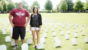 Jacob Holmes and Courtney Brown, members of Troy Students for Life, a pro-life campus organization, erected 310 tombstones on the Bibb Graves Quad Thursday. Each tombstone represented 10 babies who are killed every day by abortion. MESSENGER PHOTO/JAINE TREADWELL