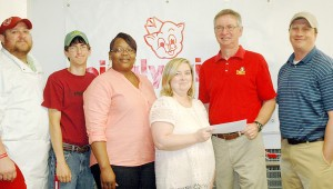 Messenger Photo/Jaine Treadwell Piggly Wiggly 231 in Troy made a donation to the Troy Miracle League.  Jennifer Garrett, store owner, presented the the Dan Smith, Troy Parks and Recreation director. Also pictured, from left, are winners of the silent auction, Derek Wilhelm, Wesley Best, Robyn Thomas, Garrett, Smith, and Shane Davenport.