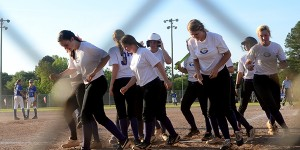 Messenger Photo/Scottie Brown Carmen Kellyis met at the plate by her fellow Goshen teammates after hitting a home run during the Eagles' outing agaisnst Reeltown.