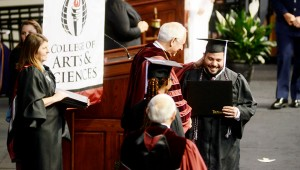 Troy University's main campus delivered diplomas to more than 880 students at Friday's commencement ceremony. Troy University Chancellor Dr. Jack Hawkins, Jr. applauded said that this may have been the largest graduating class he has seen.
