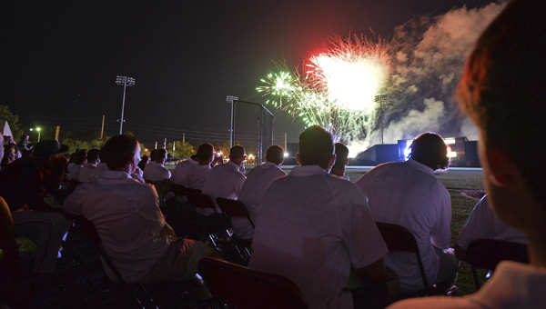 Photo/Thomas Graning Troy players watch fireworks at the end of the opening ceremonies and family night for the Sun Belt Conference baseball tournament at Riddle-Pace Field Tuesday.