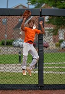 Jabronski Williams catches a ball during the American Legion Post 70 17-under team's practice at Riddle-Pace Field Wednesday. (Photo/Thomas Graning