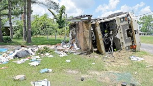 Messenger photo/Thomas Graning Officials investigated a single vehicle wreck on Alabama Highway 125 in the Tarentum community of Pike County Friday. An Advanced Disposal garbage truck flipped in a sharp turn on the road. The driver was uninjured in the wreck.