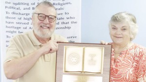 """Messenger Photo/Jaine Treadwell Dr. Ed Merkel, chair of the Troy Exchange Club's awards committee, presented the """"Book of Golden Deeds Award"""" to Donna McLaney, who volunteers with many charitable organizations throughout the county."""