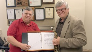 Submitted Photo Director james Smith, left, works with his brother, Ray, to prepare for his big band saxophone solo at the Southeast Alabama Community Band concert. Monday at 7 p.m. at the Crosby Theater.
