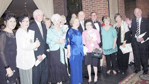 """Messenger Photo/Jaine Treadwell A large gathering of Trojans attended the  """"Celebration of the Arts"""" gala Wednesday in support of Mack Gibson who received a 2015 State Arts Award. Gibson is pictured with a group of his supporters during the reception that followed the ceremony at the Alabama Shakespeare Festival."""