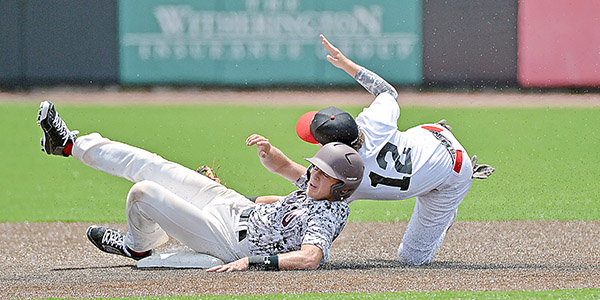 A South Lamar Post 34 player tags Post 70 Black's Mckenzie Hicks out at second during a game at Riddle-Pace Field during an early-afternoon game Friday.  MESSENGER PHOTO/THOMAS GRANING