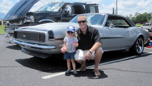 Submitted photo Corey Albertson from Fort Rucker won Best in Alabama with his 1968 Chevy Camaro RS/SS. He is pictured with his daughter, Laila.