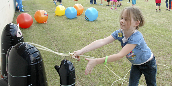 The Troy Public Library hosted a super hero training academy Tuesday that boasted more than 100 participants. Above, Morgan Penn, little Wonder Woman, learned to rope the invaders. MESSENGER PHOTO/JAINE TREADWELL