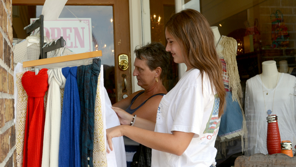 Deborah Griggs, left, and Kelsey Anderson, right, shop at Pink Parlor.  MESSENGER PHOTO/SCOTTIE BROWN