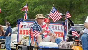 MESSENGER PHOTO/ SCOTTIE BROWN Meeksville Volunteer Fire Department hosted its fourth annual Fourth of July parade on Saturday. There were more than 50 entries in the parade ranging from vintage cars to motorcycles to horses decked out in patriotic-themed gear.