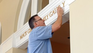 MESSENGER PHOTO/COURTNEY PATTERSON The Johnson Center for the Arts will celebrate the arts center's Donor Appreciation Day from 2 until 4 p.m. Sunday and the public is invited. Jeff Ryan with Blockwire Manufacturing in Goshen places letter at the main gallery's entrance in preparation for Sunday.