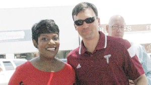 MESSENGER PHOTO/JAINE TREADWELL Brown Bag on The Square kicked off the 2015 football season Thursday with Tonya Terry, WSFA-TV personality, and Troy University head football coach Neal Brown. Charles Henderson High School head coach Brad McCoy and Pike Liberal Arts head coach Gene Allen were also there. Pictured above are Terry and Brown.