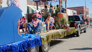 MESSENGER PHOTO/COURTNEY PATTERSON Charles Henderson High School marched in the annual CHHS Homecoming Parade Friday afternoon in Downtown Troy. The CHHS seniors created a Hawaiian-themed float.