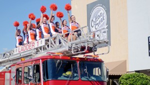 MESSENGER PHOTO/COURTNEY PATTERSON Charles Henderson High School marched in the annual CHHS Homecoming Parade Friday afternoon in Downtown Troy. CHHS cheerleaders ride atop a fire truck as they lead the audience in CHHS cheers.
