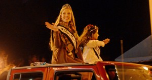 """MESSENGER PHOTO/COURTNEY PATTERSON The City of Troy held its annual Christmas parade Monday night, followed by the Christmas tree lighting. Almost 100 floats participated in the parade. The Troy University Gospel Choir performed a selection, and Miss Troy University sang """"Silent Night."""" Rev. Roland Austin gave a Christmas message and held a community prayer. Troy Mayor Jason Reeves, along with five student helpers from schools across the county lit the Christmas tree to end the night."""