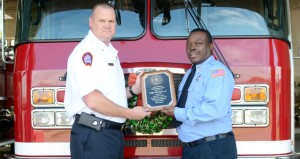 MESSENGER PHOTO/COURTNEY PATTERSON Capt. Buford Stephens, left, congratulates Senior Firefighter Willie McGuire for receiving the Humanitarian Award from the Pike County Firefighters Association.