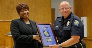 MESSENGER PHOTO/COURTNEY PATTERSON Joyce Peagler retired from the Troy Police Department Friday as a dispatcher. Peagler served for 27 years, longer than anyone in the history of the City of Troy. Above, Troy Police Chief Randall Barr congratulates and thanks Peagler for her service during her retirement ceremony Friday.