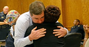 MESSENGER PHOTO/COURTNEY PATTERSON Troy Mayor Jason Reeves hugs Peagler after sharing stories of how she has served in the past 27 years.
