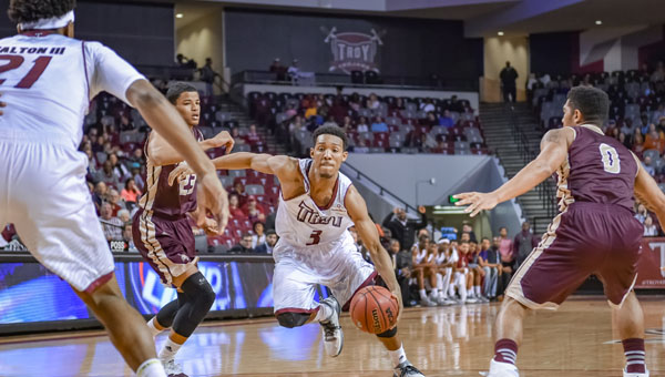 submitted Photo/Chris Davis Wesley Person attempts to drive the lane Saturday afternoon against Texas State. Person and the Trojans picked up their conference win of the season by defeating the Bobcats 66-57.