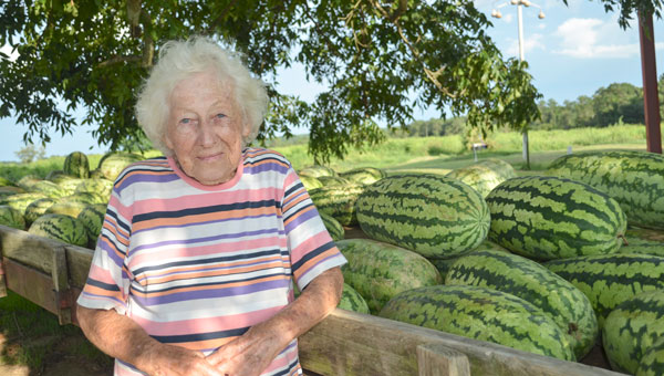 For 15 years, Mattie Renfroe and her husband, Hubbard have been planting and selling watermelons under the shade tree in their yard on Highway 29 just north of Banks. Renfroe enjoys the company of her customers, some travelers and some locals.