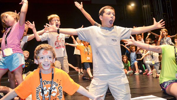 """Woody Fipps, right, will play the role of the Older Simba in the Creative Drama Camp's showcase production of """"The Lion King"""" at the Claudia Crosby Theater Friday night.  Brady Singleton, left, will perform as Timon."""