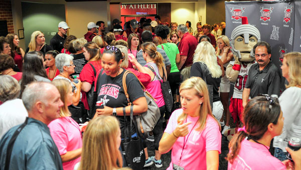 More than 100 women from the Pike County community participated in Troy University's Football 101 event this week. The women's clinic gives participants a chance to  view the game of football in a different way. PHOTO BY JOEY MEREDITH