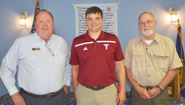 Jerry Miller program host, Troy head coach Neal Brown and Terry Hassett, club president posed after the coach spoke to members of the Exchange Club last week.