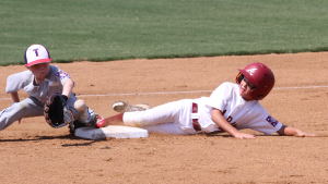Photo/dan smith The Troy Machine Pitch team's season came to an end on Monday afternoon when they fell to Texas 5-3. Top: Alabama player Ford Hussey is safe as he slides into second base against Texas in the World Series Monday in Laurel, Miss. inset: Alabama (Troy) outfielder Owen Pugh makes a catch against Texas Monday in the Pitching Machine World Series in Laurel, Miss.